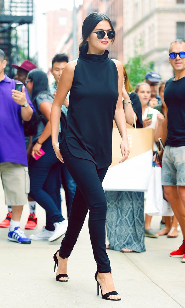 All Noir from Selena Gomez's Street Style  Pause and take in the simple sophistication that is this look—ready? Selena is nothing short of flawless in an all-black ensemble (wearing L'Agence jeans) with on-trend circle shades. Via stylebabe105