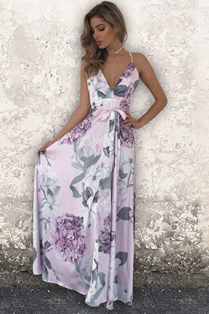 Gorgeous print maxi with aV-neckline and adjustable across back. Beautiful floral maxi dress for summer!