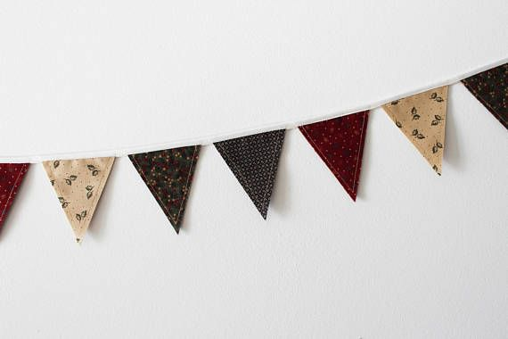 """Gooseberry Lane Mini Fabric Bunting. Description  Fabric bunting can be used over and over again! Party decorations, nursery or kid's room decor, over a doorway or around a window, the options are endless!     These bunting strands each have 18 double-sided flags measuring 3"""" by 3.5"""". The total length of each bunting strand is 6 feet. The bunting has been treated with a spray starch alternative, and can be ironed as needed. #theevergreencollective"""