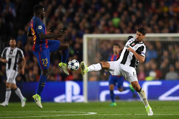 Samuel Umtiti of Barcelona and Sami Khedira of Juventus battle for possession during the UEFA Champions League Quarter Final second leg match between FC Barcelona and Juventus at Camp Nou on April 19, 2017 in Barcelona, Catalonia.