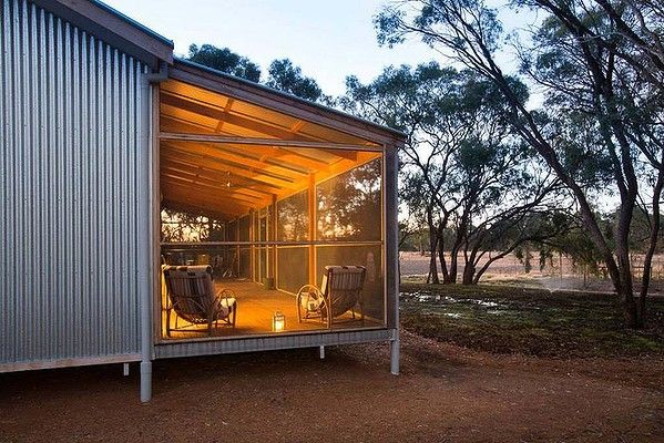 Dubbed the Shearing Shed, a home north of Echuca looks like a classic bush outbuilding, but behind the large barn doors, it is a cosy designer home with a lofty, lantern ceiling.