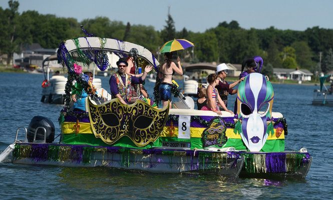 The Event Consists Of Area Residents Decorating Pontoon Boats According To A Central Theme And Parading Around The Lake In Boat Parade Pontoon Boat Lake Rafts