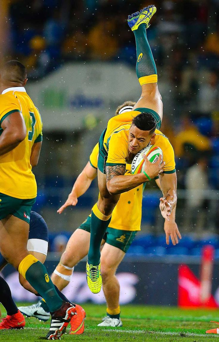 Australia's Israel Folau lands after collecting a high ball