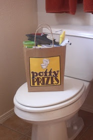 Potty Prizes.. this is a good idea, too!  So far the treat jar has been working.  I'm sure you could combine them together.
