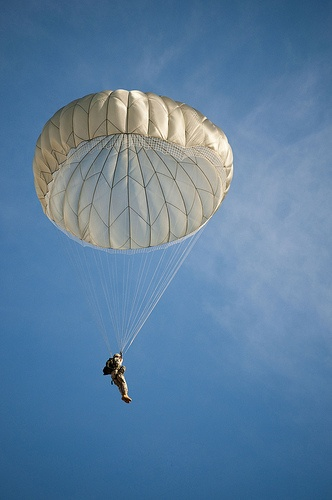 More than 1500 paratroopers drop onto Sicily Drop Zone, Fort Bragg, N.C., during the 14th Annual Randy Oler Operation Toy Drop jump earning their foreign jumpwings. Hosted by U.S. Army Civil Affairs & Psychological Operations Command (Airborne) Dec. 10. This jump is the largest combined airborne operation in the world.