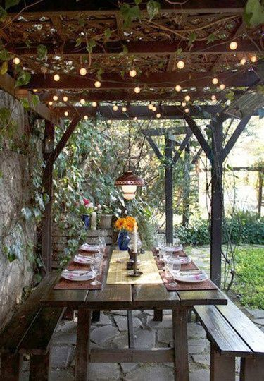 would be perfect by front firepit area- especially the pergola and lights. Grow privet in front of wall.