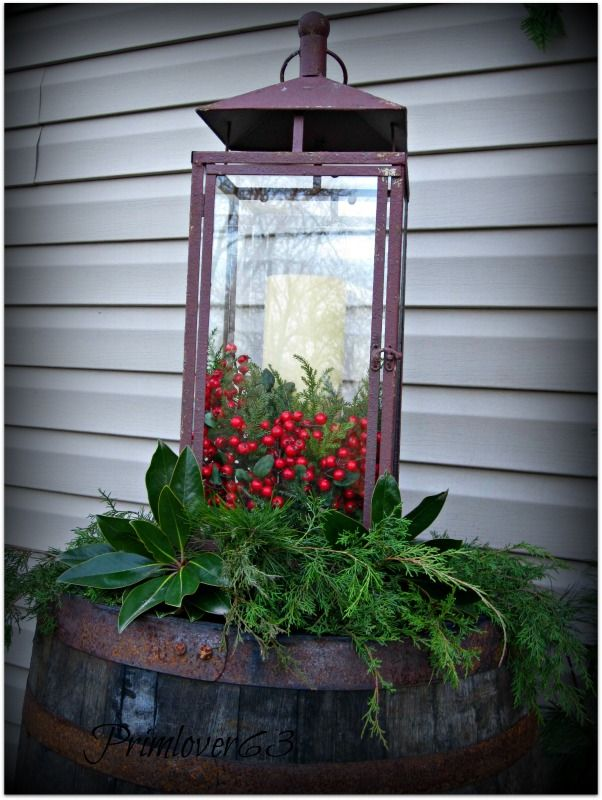 lantern....check..  whiskey barrel....check.... berries.....check... all I need is the greens .. easy and inexpensive....LOVE!!