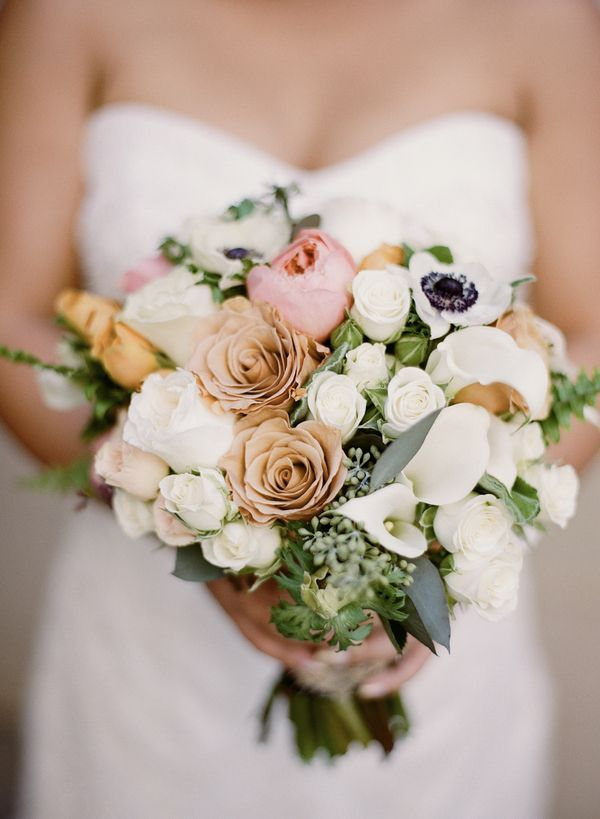 The bride's bouquet featured a lush array of white and blush blossoms, including roses, calla lilies and anemones, among others. |  Photo by Rebecca Yale Portraits, Floral Design by Oak and the Owl and Mulberry Row