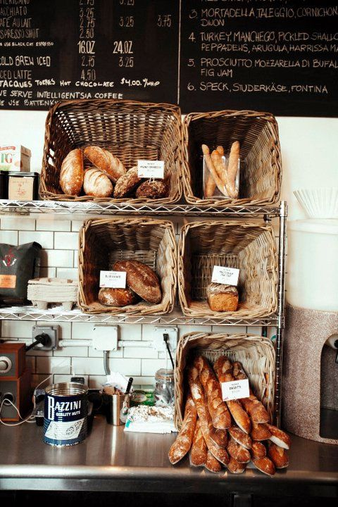 What a great twist on everyday cafe storage.  I love the baskets turned face on. Economical but provincial.   #Dépanneur | New York