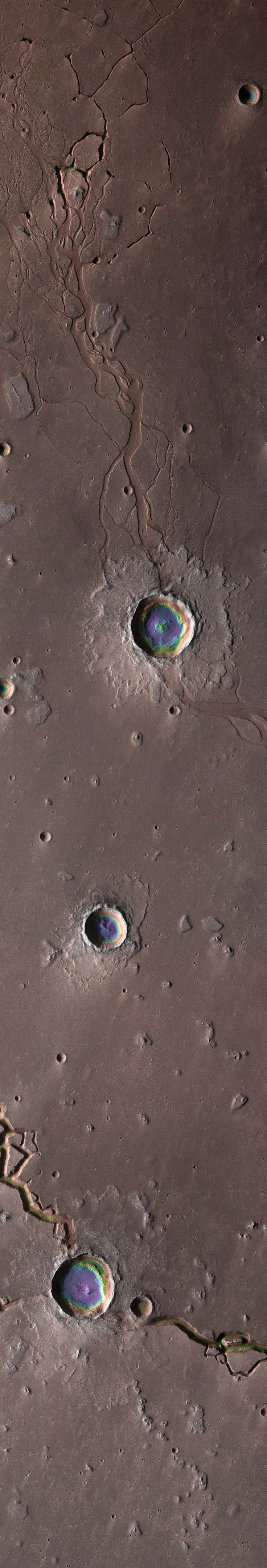 The Depths of Hephaestus Fossae (a system of troughs and channels in the Cebrenia quadrangle of Mars). Las Profundidades de Hephaestus Fossae (un sistema de artesas y canales en el cuadrilátero Cebrenia de Marte).