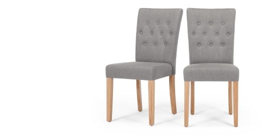 The Flynn dining chairs in graphite grey add an elegant twist to any dining room.