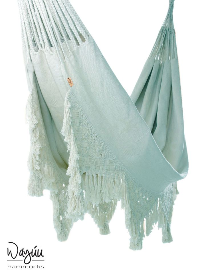 Embrace the healing serenity of a handwoven creation with this piece, tinted in a pale blue hue to radiate tranquility throughout your living space. Handcrafted by artisans, this hammock will add a touch of delicate design to your home.
