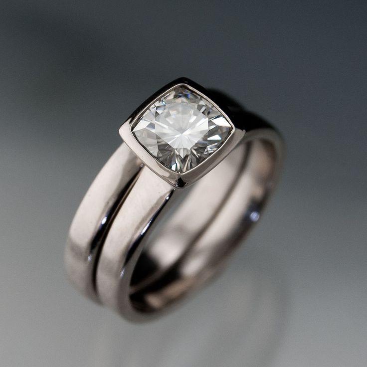 Moissanite Bezel Set Cushion Engagement Ring and Wedding Band Bridal Set in Silver/Palladium. $815.00, via Etsy.