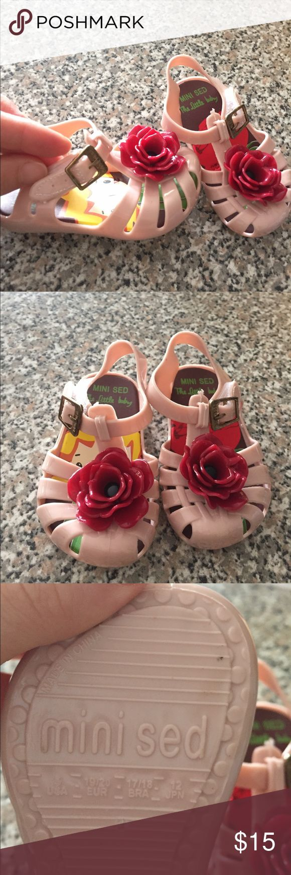 Size 5 mini Melissa imitation Never use these shoes I got them for my baby and they run a bit smaller than I expected.  They are super high-quality comfortable imitation of mini Melissa Shoes. Perfect for dressing up or casual outings for a little walker. Shoes Sandals & Flip Flops