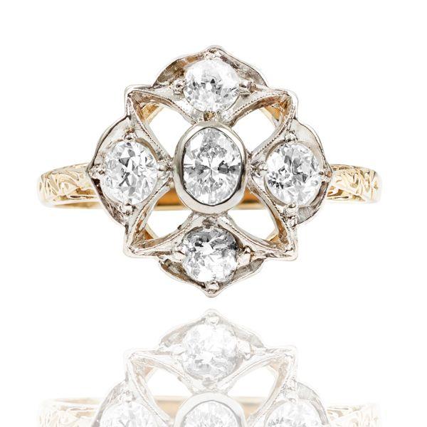 Art Deco Diamond Daisy Ring Set With An Oval Diamond And Round Cut Diamonds