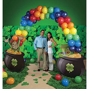 The St. Pat's Balloon Arch features two pots of gold, leperchun and balloon rainbow. Each of the St. Patrick's balloon arches is made from cardboard and 6 dozen assorted color balloons.