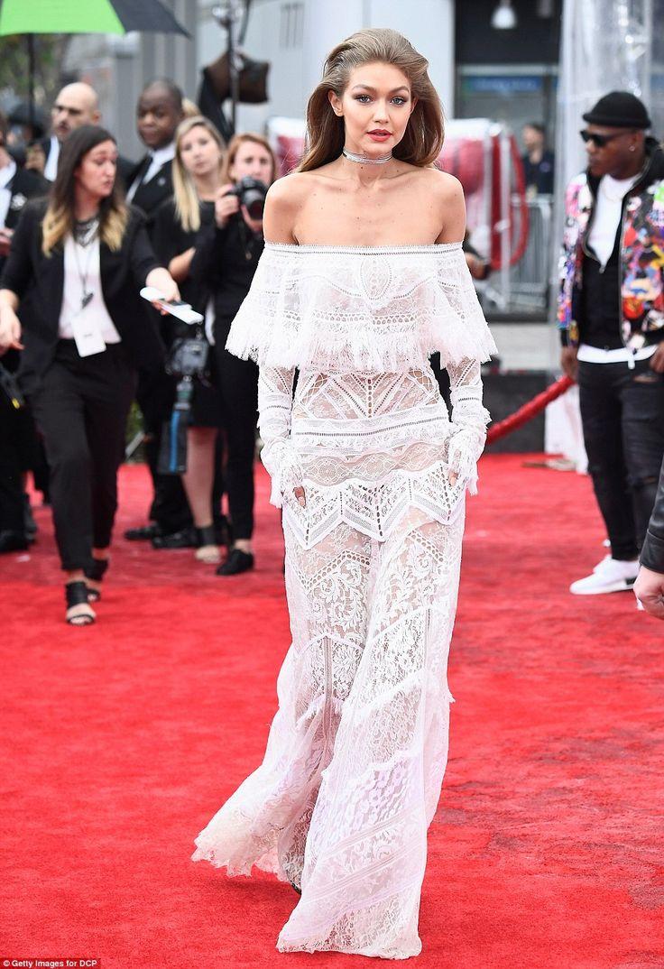 Making her entrance! Gigi will be hosting the award show with SNL star Jay Pharoah...