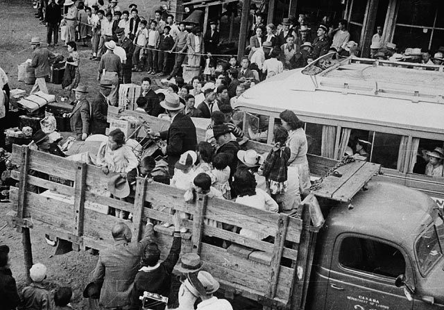 This picture shows Japanese-Canadians being taken to internment camps in the interior of British Columbia in 1942. The government sanctioned this forced relocation due to concerns the Japanese would act as spies, and also for their protection against anti-Japanese attacks.