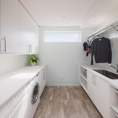 Laundry Room Design; Love the idea of metal rod for hanging Ironed/ wet clothes. great!