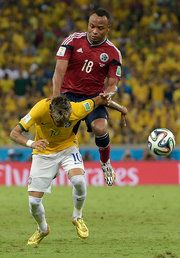 Brazil 2 Colombia1 : Neymar's injury is sustained following this collision with Zuniga, and detracts from the victory.