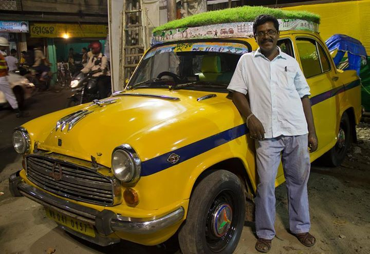 A Cab Driver in Kolkata decided to create a rooftop garden on his Ambassador Taxi. His taxi, apart from having a green grass-bed on the roof, has eight potted plants in the trunk and has a green interior completely to promote the message that trees and plants should be planted and taken care of.