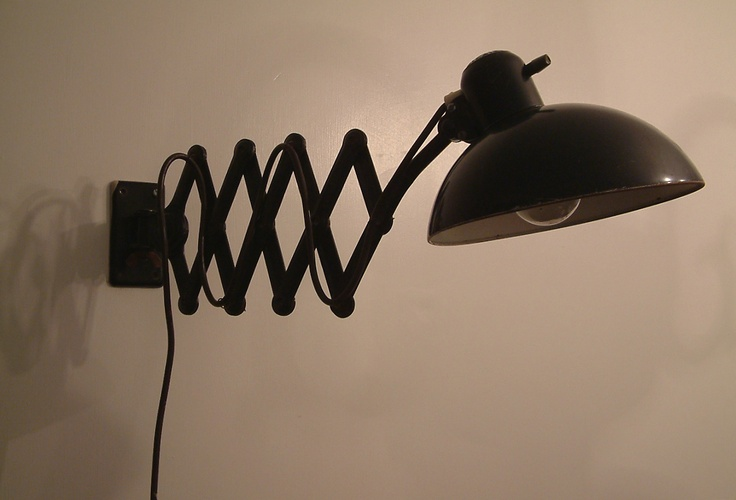 Wall lamp by Christian Dell for Gebruder Kaiser & Co, Germany, c.1930 | This is one of Dell's lighting creations that employed the time-honoured mechanism of a pantograph to provide manoeuvrability. As the teacher  in charge of the Weimar Bauhaus metalwork department, Dell had worked in close collaboration with Laszlo Moholy-Nagy, Marianne Brandt and Hans Przyrembel.    But it was at the Frankfurter Kunstchule, after 1926, that he won the commission from Kaiser | Room-606.com