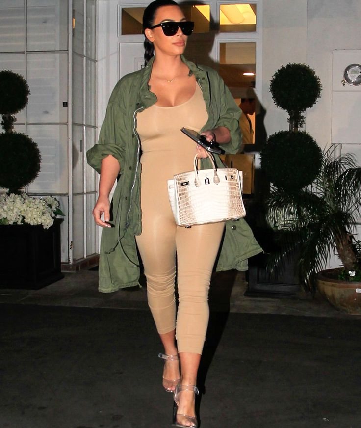 Kim Kardashian flaunts her post-baby bod in a nude jumpsuit! | toofab.com
