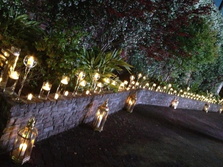 A beautiful candle light glow created by firefly ambiance in the courtyard.