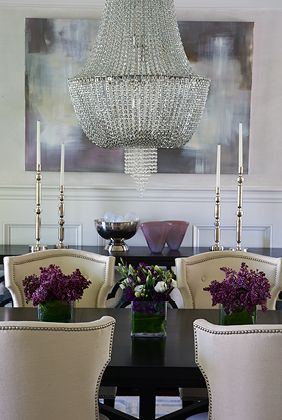 Dining room design by Nancy Galasso for Lillian August. Large chandelier and contemporary painting make the room interesting. Photography by Lorin Klaris