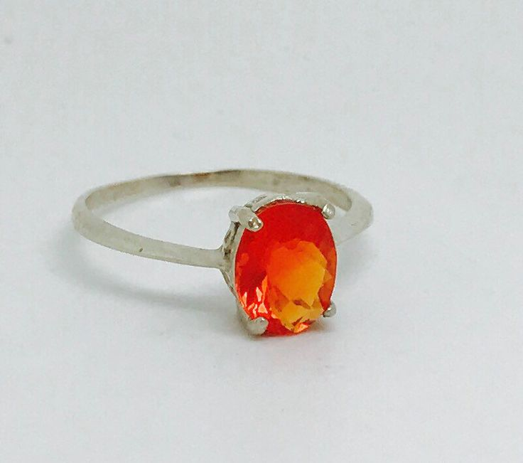 Mexican Fire Opal Ring on Sterling Silver by TheMexicanOpalHouse on Etsy https://www.etsy.com/listing/495199047/mexican-fire-opal-ring-on-sterling