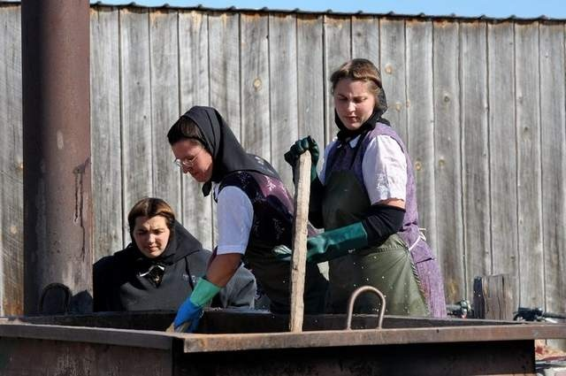 The Hutterites Sarah, Pam and Amanda stirring soap.