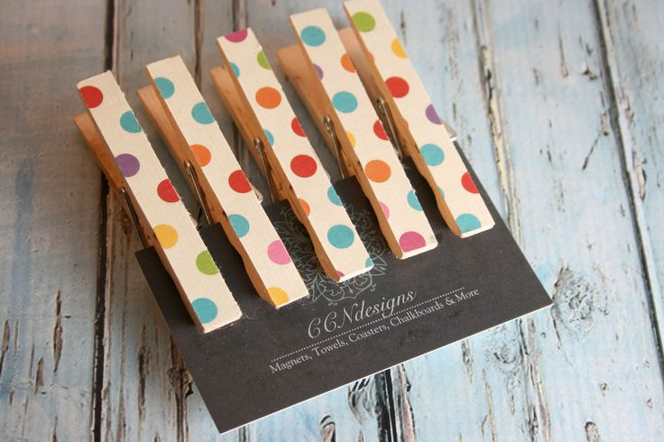These are made of natural wood and covered with decorative paper on one side with a magnet on the other. The paper features a multicolor polka dot design. These are perfect for holding important paper