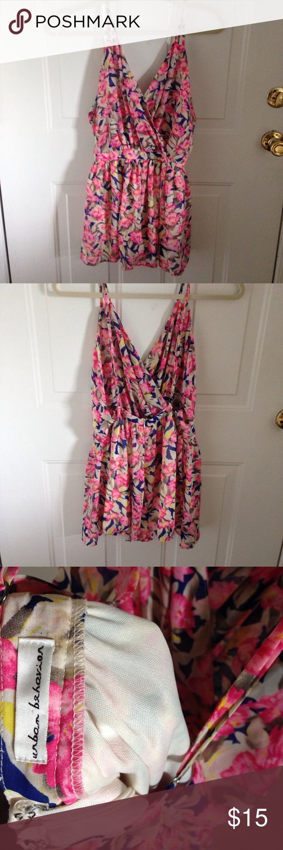 floral, colorful, flirty romper or coverup worn a few times! adorable romper. open back withe adjustable straps. purchased from a boutique in arizona. originally had a size medium on the tag. would best fit a 4 or 6 in my opinion Urban Behavior Other