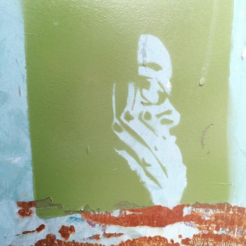 A stenciled self portrait JUST HAPPENED to show up on the dumpster behind my apartment building a few minutes ago.