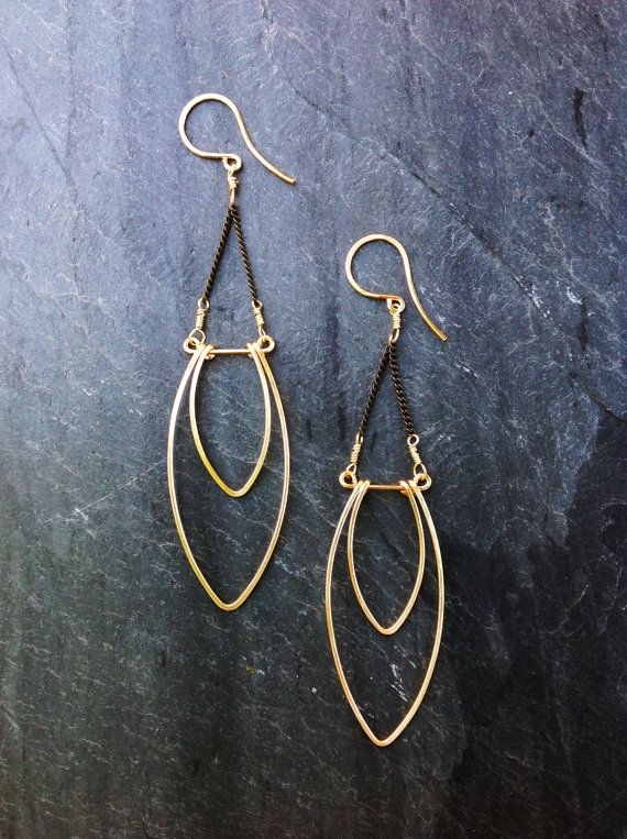 Hey, I found this really awesome Etsy listing at https://www.etsy.com/listing/192350783/geometric-hammered-gold-flame-earrings