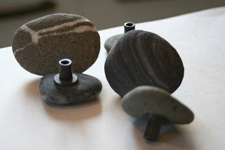 How to make drawer pulls - she used river rock but I thought they would be great with large colorful buttons for a sewing room.