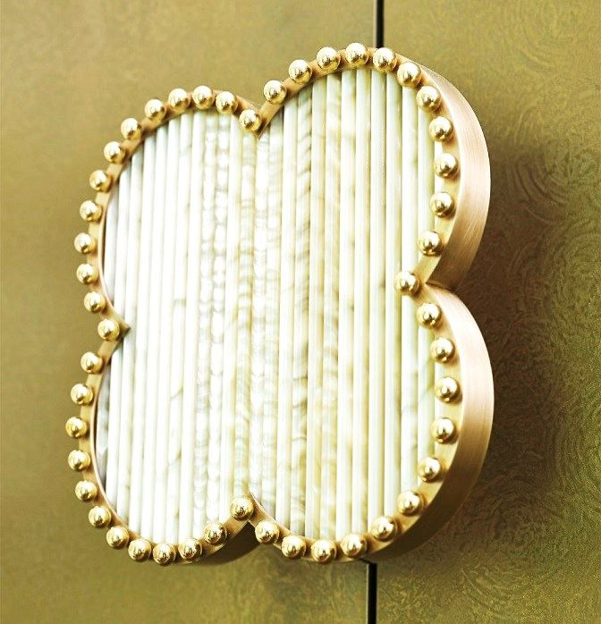 A real interior jewel - the bespoke, hand-made of nacre sticks and brass handle of the HAPPY CLOVER cabinet by MARI IANIQ. #MARIIANIQ #luxury #bespoke #handmade #jewel #nacre #sticks #brass #HAPPYCLOVER #cabinet #interiors #design #decor
