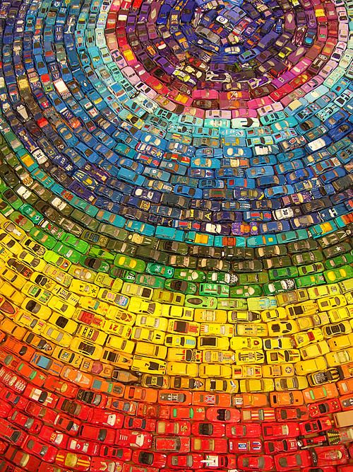 The Toy Atlas Rainbow is a wonderful installation of 2,500 old toy cars by UK artist David T. Waller.