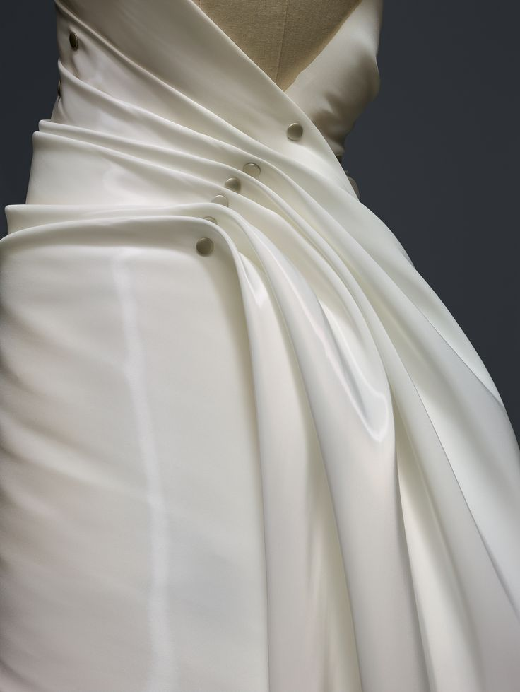 "Miyake Design Studio (Japanese, founded 1970). Issey Miyake (Japanese, born 1938) . ""Colombe"" Dress (detail), spring/summer 1991, Prêt–à–Porter. Laser–cut white polyester monofilament twill, hand–riveted silver metal snap closures, hand–riveted brown leather straps. Photo © Nicholas Alan Cope. #ManusxMachina #CostumeInstitute"