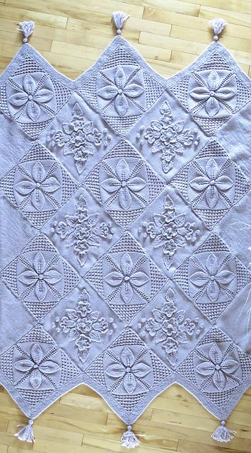 Baby blanket idea: counterpane squares mixed with plain garter squares, all sewn in the diagonal (diamond shape) to form points ~~ Ravelry: Project Gallery for Counterpane Afghan pattern by Nicky Epstein