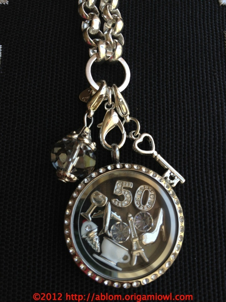 Fifty shades of Grey, Origami Owl locket and charms. Lg Silver with Crystals Locket, Charms; Plane, wine glass, tea cup, High heel, Eiffel tower, two clear crystals for diamonds, 5 and 0 numbers, Key and Vintage Grey dangle.