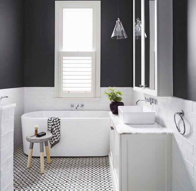 In love with this bathroom! White subway tile, statement floor tiles from Jatana Interiors, Dulux 'Domino' wall colour, stone vanity top and a big window to let it lots of natural light.