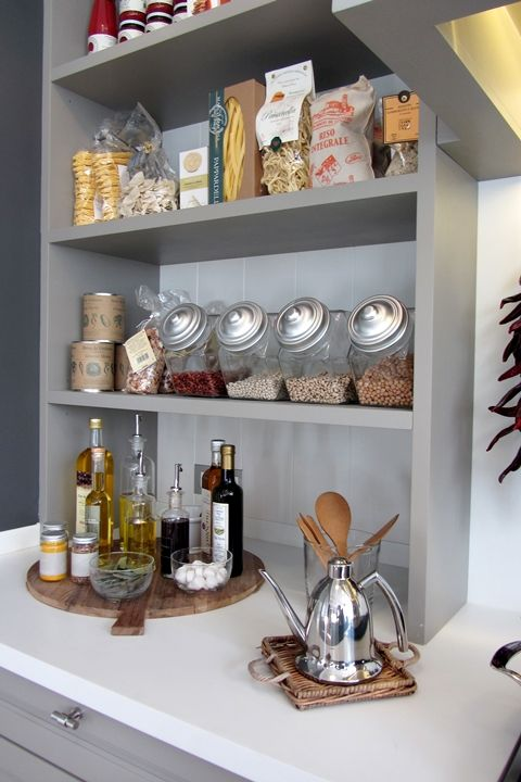 kitchen organization + display; the open-air storage means needing to be extra organized! Love the gray on white contrast.   Where do I get these nifty canisters?