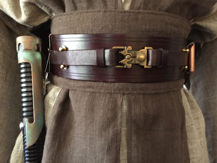 linen belt with velcro on back to hold, then big leather piece with velcro, and thin brown belt
