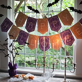 Make your own spooky Halloween Decorations with the printable template for this paper garland featuring ghosts, cats, bats, and skeletons! by Lia Griffith