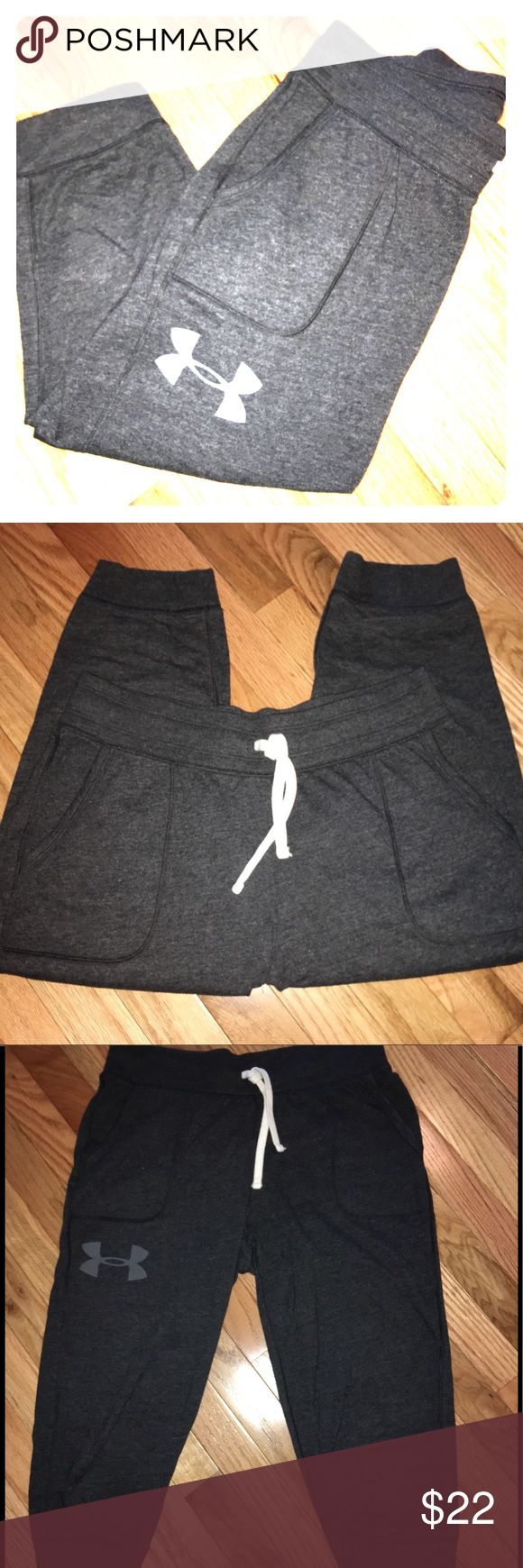 """Under Armour Women's Crop Jogger Sweatpants Color: Dark Grey Size: Medium Cotton-rich tri-blend fabric has a soft, athletic feel for superior comfort. Signature Moisture Transport System wicks sweat so it dries faster than ordinary cotton. Lightweight stretch construction improves mobility for full range of motion. Anti-odor technology keeps your gear fresher. Stretchy, wide ribbed waistband with external drawcord. Patch front pockets. Ribbed cuff hem. Approx. inseam: 21"""" 55% cotton/34%…"""