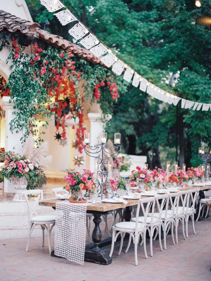 Spanish-inspired wedding table decor: http://www.stylemepretty.com/2017/05/22/spanish-wedding-rancho-las-lomas/ Photography: McCune - http://mccune-photography.com/