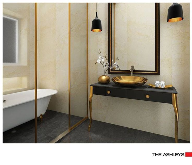 This one of a kind bathroom redefines luxury. The golden washbasin, vase and other elements add the touch of glamour to its chic and aesthetic interiors. #TheAShley #Bling #Bathroom