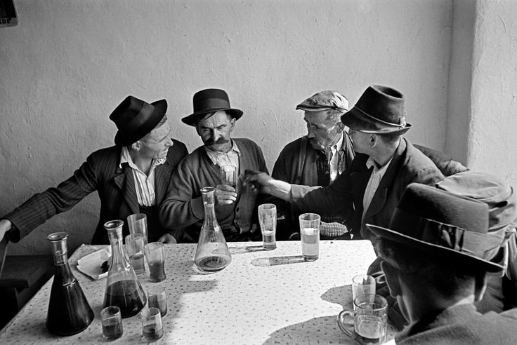 Werner Bischof - Men gather to drink in the Farmers Inn - Hortobágy, Hungary 1947.  Magnum Photos