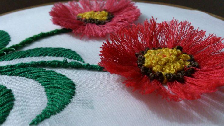 Hand embroidery- pom pom flower stitch-leisha's galaxy. I used pom pom stitch for flowers, portugese knotted stem stitch for stem, harring bone stitch for le...
